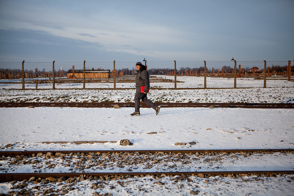 A tourist guide at the Auschwitz Birkenau site. It is estimated that between 1.1 and 1.5 million Jews, Poles, Roma and others were killed in Auschwitz during the Holocaust in between 1940-1945.