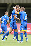 Paul Robinson and Dannie Bulman during the Pre-Season Friendly match between AFC Wimbledon and Cheltenham Town at the Cherry Red Records Stadium, Kingston, England on 1 August 2015. Photo by Stuart Butcher.