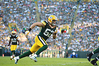 Green Bay Packers linebacker Clay Matthews (52) runs on the field against the San Francisco 49ers during an NFL football game in Green Bay, Wisconsin Saturday, Sept. 9, 2012. (AP Photo/Tom Hauck)