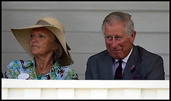 HRH The Prince of Wales in the Royal box with Clare Tomlinson watching the  Audi International Polo 2013-Westchester Cup Polo match Audi England v Equus & Co USA at the <br /> Guards Polo Club, Egham, United Kingdom,<br /> Sunday, 28th July 2013<br /> Picture by Andrew Parsons / i-Images