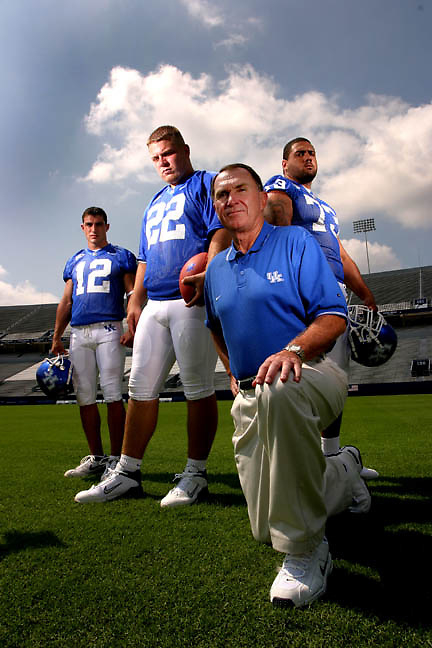 University of Kentucky  receiver Derek Abney, quarterback Jared Lorenzen, Coach Rich Brooks, and lineman Antonio Hall photographed for preview cover at Commonwealth Stadium on friday August 8, 2003 in Lexington, Kentucky.