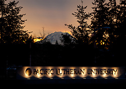 Mi. Rainier at sunrise with Pacific Lutheran University sign Thursday, Jan. 12, 2012.
