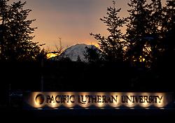 Mi. Rainier at sunrise with Pacific Lutheran University sign Thursday, Jan. 12, 2012.