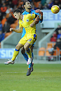 Bristol Rovers Forward, Tom Nichols (10) and Blackpool Goalkeeper, Christoffer Mafoumbi (37)   during the EFL Sky Bet League 1 match between Blackpool and Bristol Rovers at Bloomfield Road, Blackpool, England on 3 November 2018.
