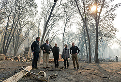 November 17, 2018 - Paradise, California, U.S. - Gov.-elect GAVIN NEWSON, FEMA Director BROCK LONG, President DONALD TRUMP, Paradise mayor JODY JONES and Gov. JERRY BROWN tour the Skyway Villa Mobile Home and RV Park with Gov. Jerry Brown during his visit of the Camp Fire in Paradise. The Camp Fire in Northern California has become the nation's deadliest wildfire in a century and has killed at least 63 people and left more than 1000 still missing. (Credit Image: © Paul Kitagaki Jr/Sacramento Bee via ZUMA Wire)