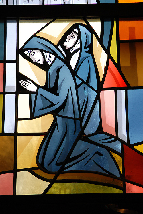 Stained glass image of  kneeling nuns inside Our Lady Queen of Peace Church in Milwaukee . (Photo by Sam Lucero)