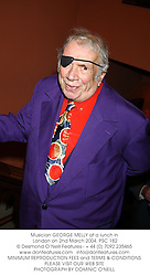 Musician GEORGE MELLY at a lunch in London on 2nd March 2004.PSC 182