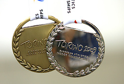 Medals of Sonja Roman, third at the 1500m women run and Marija Sestak of Slovenia placed second at the final of Women Triple  jump at the 3rd day of  European Athletics Indoor Championships Torino 2009 (6th - 8th March), at Oval Lingotto Stadium,  Torino, Italy, on March 8, 2009. (Photo by Vid Ponikvar / Sportida)