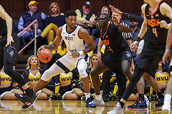 Jan 12, 2019; Morgantown, WV, USA; West Virginia Mountaineers forward Derek Culver (1) makes a move in the lane during the first half against the Oklahoma State Cowboys at WVU Coliseum. Mandatory Credit: Ben Queen-USA TODAY Sports