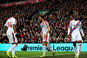 Crystal Palace midfielder Andros Townsend (10) scores a goal 0-1 and celebrates with Crystal Palace forward Jordan Ayew (14) and Crystal Palace forward Wilfried Zaha (11) during the Premier League match between Liverpool and Crystal Palace at Anfield, Liverpool, England on 19 January 2019.