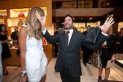 MARK JACOBS; ELLE MACPHERSON, Louis Vuitton openingof New Bond Street Maison. London. 25 May 2010. -DO NOT ARCHIVE-© Copyright Photograph by Dafydd Jones. 248 Clapham Rd. London SW9 0PZ. Tel 0207 820 0771. www.dafjones.com.