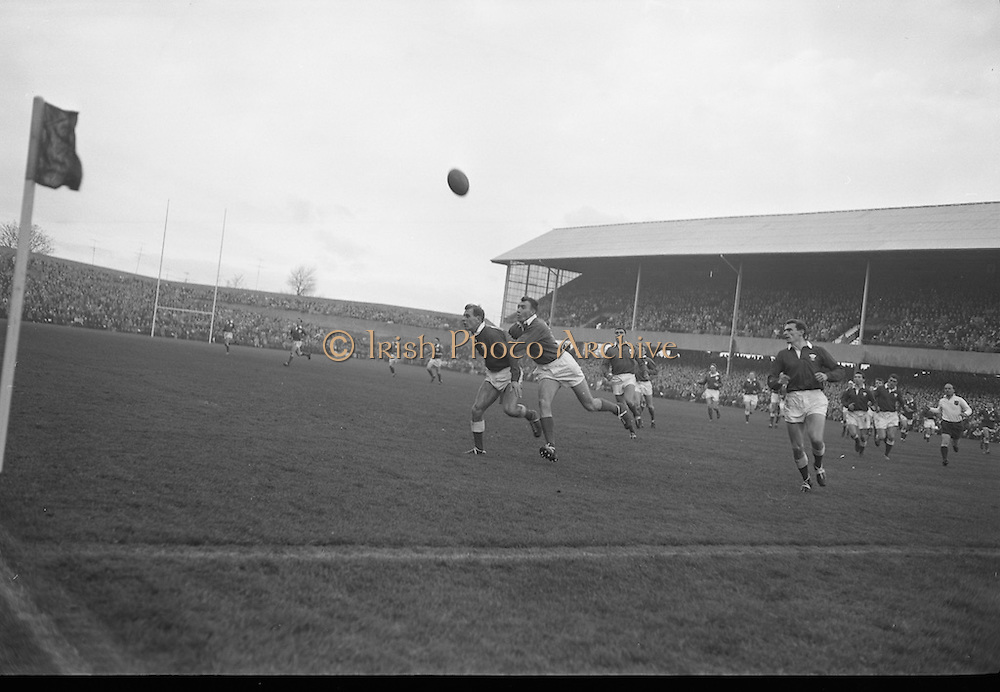 Rugby International, Ireland v Wales, Lansdowne Road, Dublin. W.R. Huntern, Ireland, tackles a Welshman, forcing him to kick wildly for touch.<br /> 17.11.1962
