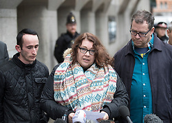 © Licensed to London News Pictures. 23/11/2016. London, UK. Mandy Pearson, step mum of victim Daniel Whitworth, stands with her husband Adam Whitworth (R) and another family member as she talks to reporters outside the Old Bailey. Stephen Port has been found guilty of three murders in his trial at the Old Bailey.Photo credit: Peter Macdiarmid/LNP