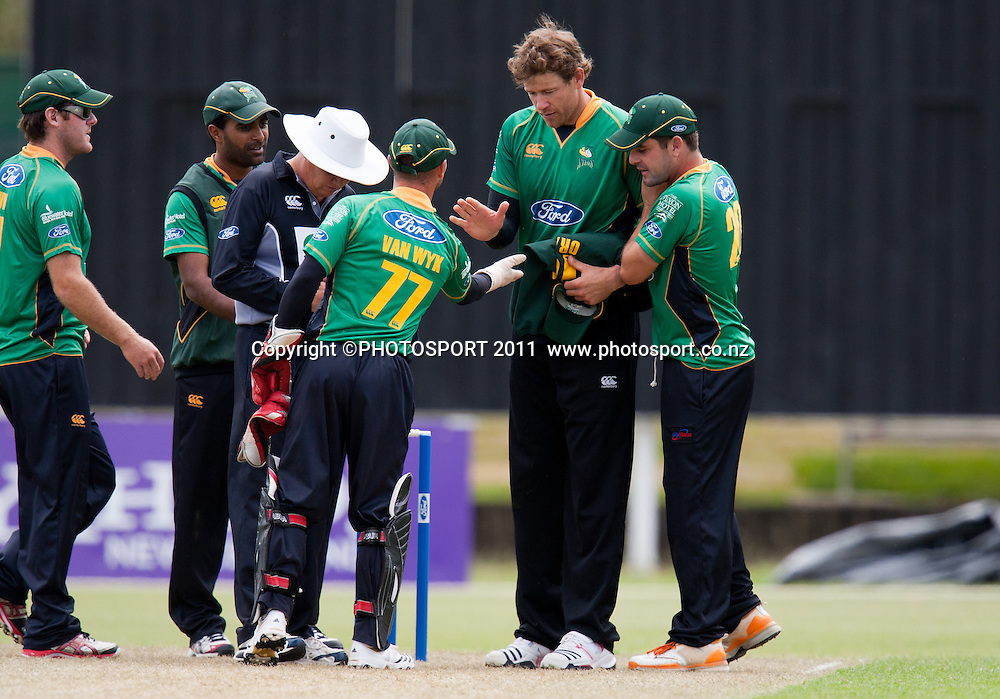 Stag's Jacob Oram is congratulated for dismissing Anton Devcich with his caught and bowled during the Ford Trophy Cricket - Northern Knights v Central Stags one day match, at Seddon Park, Hamilton, New Zealand, 11 December 2011. Photo: Stephen Barker/photosport.co.nz