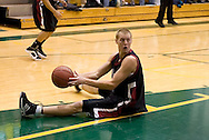 1/6/2006: After falling down while grabbing a rebound, Lance Den Boer of the Central Washington Wildcats looks to pass to a teammate in the 60-80 loss to the University of Alaska-Anchorage Seawolves at the Wells Fargo Sports Complex on the campus of UAA.<br />