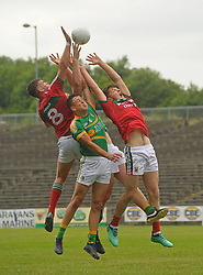 Mayo's Seán Og Tighe and Jordan Flynn contest a kickout with Leitrim's Matiss Polis during the Connacht U20 semi-final at MacHale park.<br /> Pic Conor McKeown