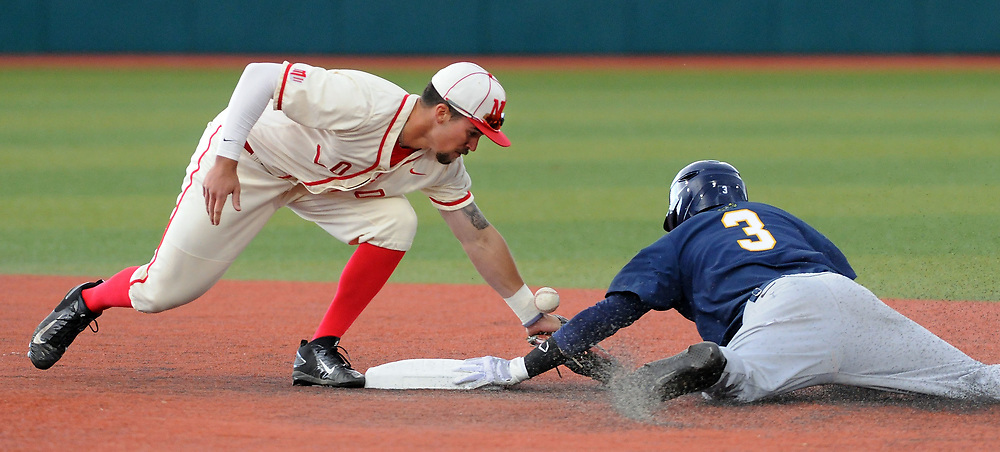 jt051817c/ sports/jim thompson/  UNM's shortstop #3 Hayden Schilling attempts to make the tag on Nevada's #3 Justin Bridgman on the steal but looses the ball. Thursday May. 18, 2017. (Jim Thompson/Albuquerque Journal)