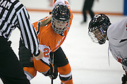 RIT Senior Captain Lindsay Grigg awaits a face-off during an exhibition game at RIT's Gene Polisseni Center on Monday, September 29, 2014.