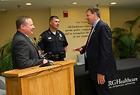 LRGH President Kevin Donovan, Laconia Police Chief Matt Canfield and Governor Chris Sununu following the bill signing at Lakes Region General Hospital on Thursday morning.  (Karen Bobotas/for the Laconia Daily Sun)