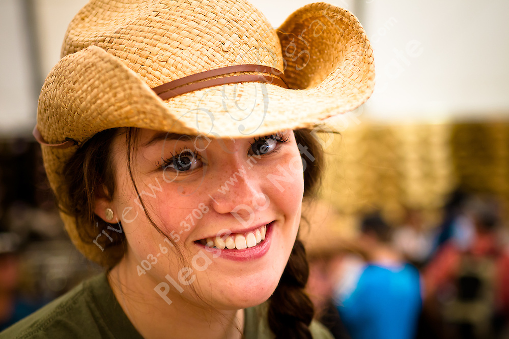 I had a great day of wandering and people watching at the Calgary Stampede. This beautiful young lady sold me a shirt at Lammles...©2010, Sean Phillips.http://www.RiverwoodPhotography.com