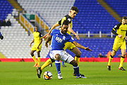 Birmingham's Jacques Maghoma holds off Burton Albion's Tom Flanagan during the The FA Cup 3rd round match between Birmingham City and Burton Albion at St Andrews, Birmingham, England on 6 January 2018. Photo by John Potts.
