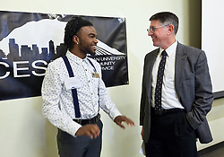 Jonathan Adams talks with President Thomas Krise at the Celebration of Service at PLU on Wednesday, April 22, 2015. (Photo: John Froschauer/PLU)