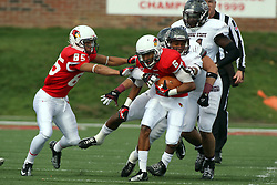 20 October 2012:  Lechein Neblett tries to remove a pair of Bears from Donovan Harden during a return during an NCAA Missouri Valley Football Conference football game between the Missouri State Bears and the Illinois State Redbirds at Hancock Stadium in Normal IL