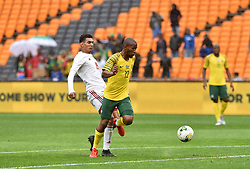 South Africa: Johannesburg: Bafana Bafana player Kamohelo Mokotjo battle for the ball with Seychelles player Karl Hopprich during the Africa Cup Of Nations qualifiers at FNB stadium, Gauteng.<br />