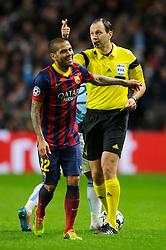 Barcelona Defender Daniel Alves (BRA) walks away after being shown a yellow card by referee Jonas Eriksson (SWE) - Photo mandatory by-line: Rogan Thomson/JMP - Tel: 07966 386802 - 18/02/2014 - SPORT - FOOTBALL - Etihad Stadium, Manchester - Manchester City v Barcelona - UEFA Champions League, Round of 16, First leg.