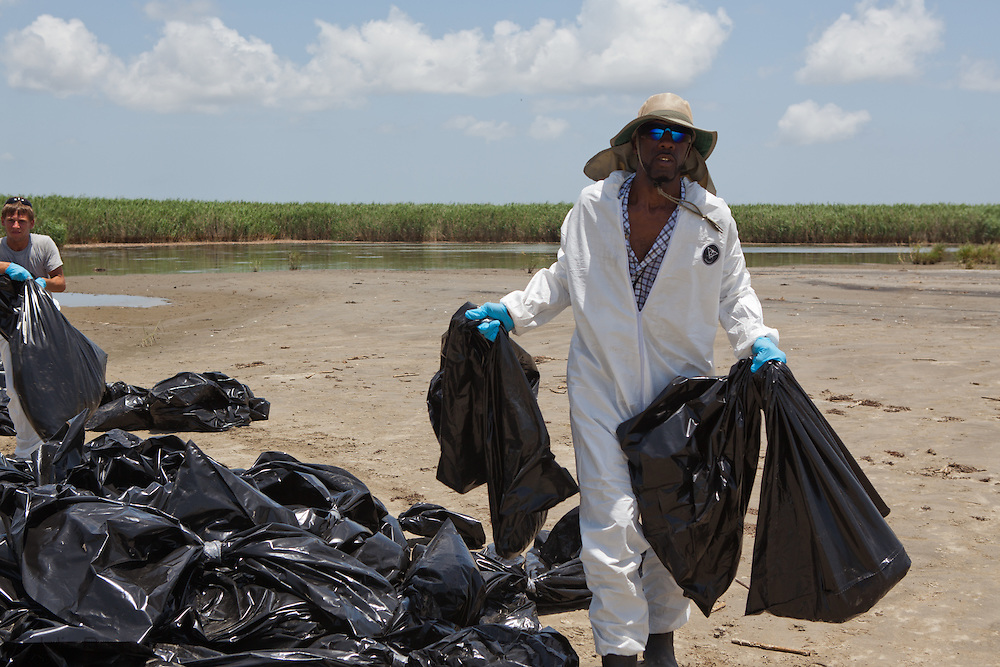 July 14, 2010,  Member of The Inland Waterway Strike Force of Plaquemines Parish, cleaning up  BP oil in on a beach on a barrier island in Plaquemines Parish.