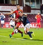 Scotland's Jason Cummings takes on FYR Macedonia's Gjoko Zajkov during Scotland Under-21 v FYR Macedonia,  UEFA Under 21 championship qualifier  at Tynecastle, Edinburgh. Photo: David Young<br /> <br />  - © David Young - www.davidyoungphoto.co.uk - email: davidyoungphoto@gmail.com