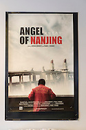 Bellmore, New York, USA. July 16, 2015. A movie poster for ANGEL OF NANJING, a documentary by filmmakers Jordan Horowitz and Frank Ferendo, is on display in the Bellmore Movies lobby during the LIIFE Awards Ceremony. The film won the Best Documentary award at the 18th Long Island International Film Expo, and is about Chen Si who has saved over 300 people from commiting suicide at the Yangtze River Bridge in Nanjing, the most popular place in the world to commit suicide.