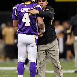 September 9, 2010; New Orleans, LA, USA; Minnesota Vikings quarterback Brett Favre (4) is greeted by New Orleans Saints head coach Sean Payton during warm ups prior to the NFL Kickoff season opener between the Minnesota Vikings and the New Orleans Saints at the Louisiana Superdome. Mandatory Credit: Derick E. Hingle