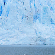 Chris Theobald getting air while stand up paddle boarding next to the Serrano Glacier in Bernado O'Higgins National Park, Chile.