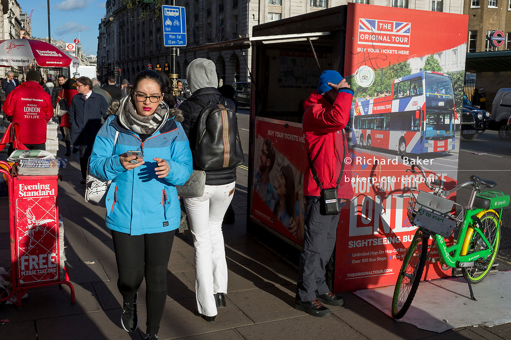 Pedestrians walk in winter sunshine opposite the Ritz Hotel on Piccadilly in central London, on 11th February 2020, in London, England.