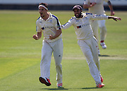 Jack Brooks celebrates with team mate Adil U Rashid  (Yorkshire CCC)  after taking the wicket of Jamie Harrison (Durham County Cricket Club) during the LV County Championship Div 1 match between Durham County Cricket Club and Yorkshire County Cricket Club at the Emirates Durham ICG Ground, Chester-le-Street, United Kingdom on 1 July 2015. Photo by George Ledger.