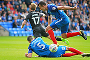 Peterborough United defender Ryan Tafazolli (5) and Peterborough United defender Steven Taylor (27) stop Wigan Athletic midfielder Michael Jacobs (17) on the edge of the box during the EFL Sky Bet League 1 match between Peterborough United and Wigan Athletic at London Road, Peterborough, England on 23 September 2017. Photo by Nigel Cole.