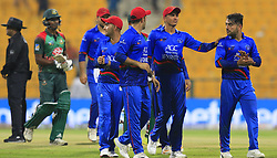 September 21, 2018 - Abu Dhabi, United Arab Emirates - Afghanistan cricketers celebrate their win over the Bangladesh cricket team during the 6th cricket match of Asia Cup 2018 between Bangladesh and Afghanistan at the Sheikh Zayed Stadium,Abu Dhabi, United Arab Emirates on September 20, 2018. (Credit Image: © Tharaka Basnayaka/NurPhoto/ZUMA Press)