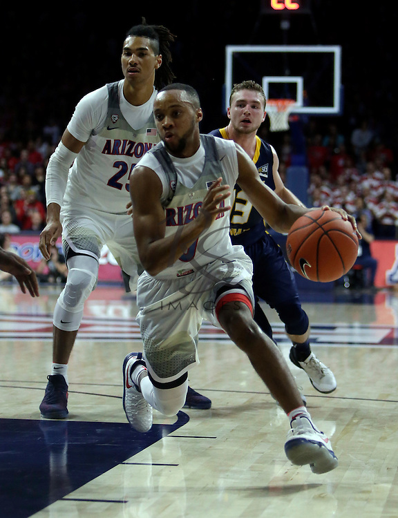 Arizona guard Parker Jackson-Cartwright (0) during the first half of an NCAA college basketball game against Northern Colorado, Monday, Nov. 21, 2016, in Tucson, Ariz. (AP Photo/Rick Scuteri)
