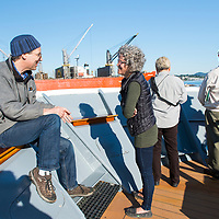 A naturalist talking to a guest on the bow of the National Geographic Sea Lion while in Nanaimo harbor in British Columbia, Canada.