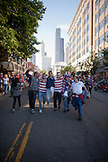 Fans walk and cheer down Occidental Avenue during the March to the Match before the USA vs. Panama Men's Soccer - FIFA World Cup qualifying match between the USA and Panama Tuesday, June 11, 2013 at CenturyLink Field in Seattle, WA.
