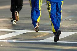 runners heading to start line of race