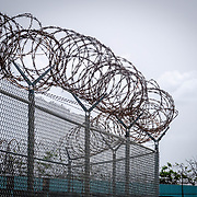 JULY 19, 2018----BAYAMON, PUERTO RICO---<br /> Barbed wire  in the Bayamon Correctional Complex which is made up of four buildings. The Puerto Rico Corrections and Rehabilitation Department is in the middle of a project to downsize by transferring inmates to private jails in the United States and closing institutions like this.<br /> (Photo by Angel Valentin/Freelance)