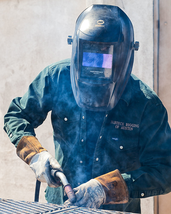 Ben Chapa of Fabtech Rigging in Pflugerville, Texas welding a barbeque pit for KJT #112.
