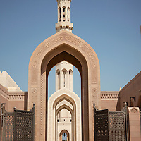 The main minaret rising over an entrance to the Sultan Qaboos Grand Mosque in Muscat. The building was constructed from 300,000 tons of sandstone and took more than six years to complete.