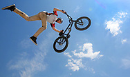 "KEENERVISION: ""LOOK MA NO FEET"" -- Austin Zentmyer of the Indianapolis, based  Wonder Wheels BMX Stunt Team flies skyward off of a ramp during their performance at the first Two Rivers Art and Music Festival in Logansport on Sunday June 12, 2016 (J. Kyle Keener/Pharos-Tribune via AP)"