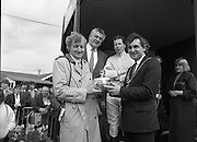 Irish Grand National At Fairyhouse.  (R54)..1987..20.04.1987..04.20.1987..20th April 1987..The Easter Racing Festival at Fairyhouse included the running of the Jameson sponsored Irish Grand National. Another featured race was the Jameson Gold Cup which was also run on Easter Monday...Mr Bertie Ahern TD, Minister for Labour and Lord Mayor of Dublin is pictured presenting the Jameson Irish Grand National Trophy to Mr Jimmy Glynn,Tuam, Co Galway owner of the winning horse 'Brittany Boy'. Included in the image are Mr Richard Burrows,Group managing Director,Irish Distillers and Mr Tom Taffe the winning jockey.