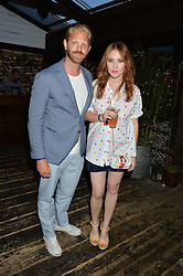 ALASTAIR GUY and ANGELA SCANLON at the Warner Music Group & GQ Summer Party held at Shoreditch House, Ebor Street, London on 17th July 2014.