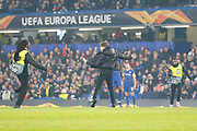 A Chelsea fan runs on the pitch chased by stewards during the Europa League match between Chelsea and Malmo FF at Stamford Bridge, London, England on 21 February 2019.
