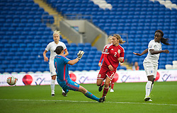 CARDIFF, WALES - Tuesday, August 21, 2014: Wales' goalkeeper Nicola Davies is beaten for the opening goal against England during the FIFA Women's World Cup Canada 2015 Qualifying Group 6 match at the Cardiff City Stadium. (Pic by Ian Cook/Propaganda)